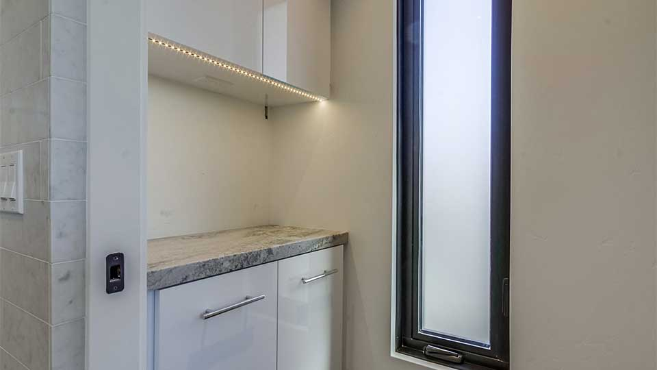 modern_high_gloss_white_cabinets_built-in