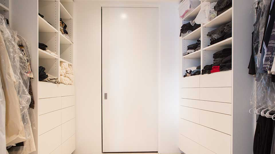 modern_high_gloss_white_closet_cabinets_in_del_mar